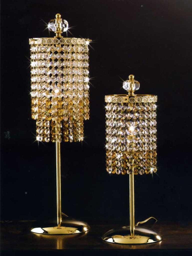 Lumi. struttura: metallo dorato, diffusori: cristalli